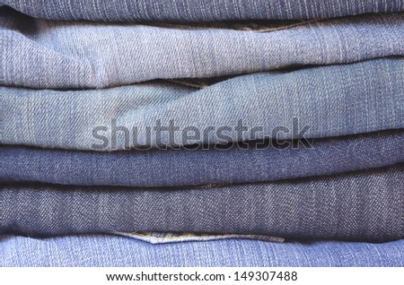 close up of a stack of folded jeans horizontally cropped
