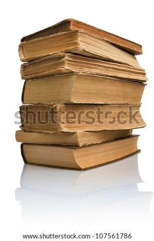 Close-up of a stack of old books with reflection
