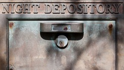 close-up of a steel bank depository