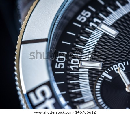 Close up of a steel chronograph. Selective focus, shallow depth of field.