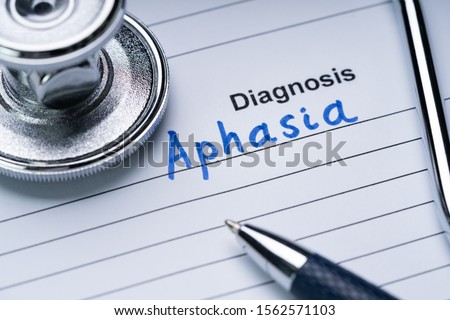 Close-up Of A Stethoscope And Pen Over Diagnostic Form With Diagnosis Aphasia