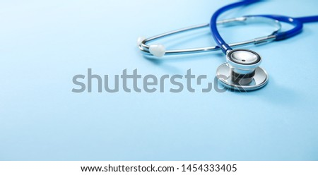 Close-up of a Stethoscope on Blue Background