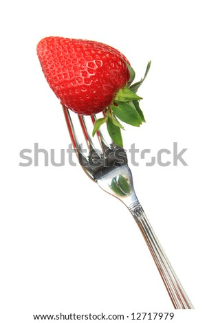 Close-up of a strawberry and fork isolated on a white background