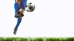 Close up of a striker who kicks the ball to make goals on a white background