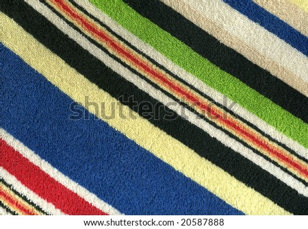 Close-up of a striped colored terry towel - stock photo
