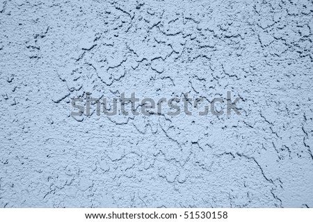 Close up of a stucco wall and the rough texture.
