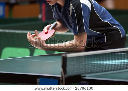 Close up of a table tennis player serving