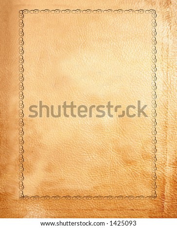 close up of a tan leather bound book