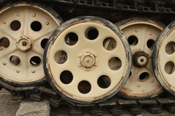 Close up of a tank's sprockets from World War Two in good condition. Retro transport and military technology concept.