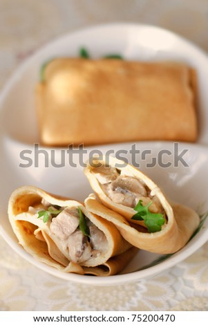 close up of a tasty pancake with chicken and mushrooms filling
