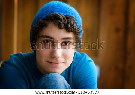 close up of a teen boy wearing a hat - stock photo