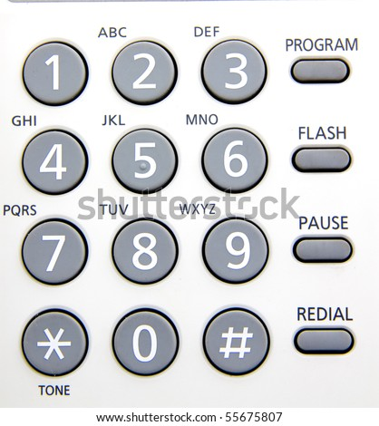 close up of a telephone  numerical keypad with gray buttons and letters