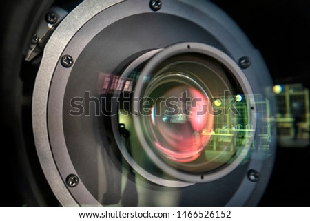 close up of a television lens  on a dark background. Camera lens,Macro of an iris,Camera - Photographic Equipment, Lens - Optical Instrument, Circle, Metal, Single Object. #1466526152