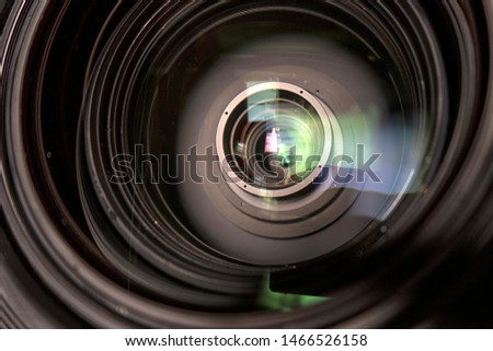 close up of a television lens  on a dark background. Camera lens,Macro of an iris,Camera - Photographic Equipment, Lens - Optical Instrument, Circle, Metal, Single Object. #1466526158