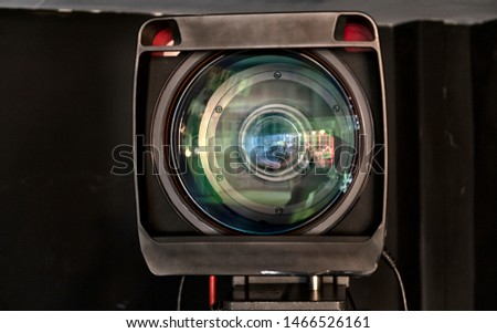 close up of a television lens  on a dark background. Camera lens,Macro of an iris,Camera - Photographic Equipment, Lens - Optical Instrument, Circle, Metal, Single Object. #1466526161