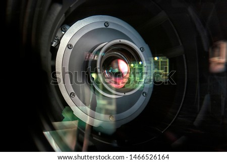 close up of a television lens  on a dark background. Camera lens,Macro of an iris,Camera - Photographic Equipment, Lens - Optical Instrument, Circle, Metal, Single Object. #1466526164