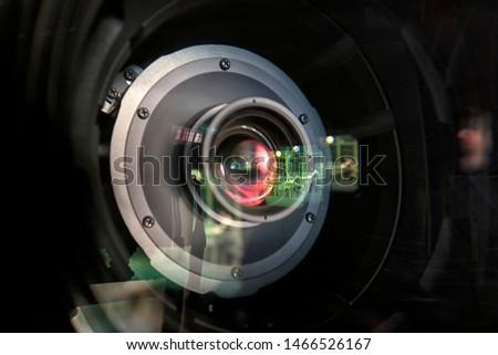close up of a television lens  on a dark background. Camera lens,Macro of an iris,Camera - Photographic Equipment, Lens - Optical Instrument, Circle, Metal, Single Object. #1466526167