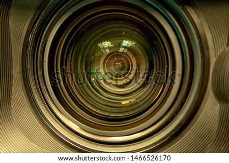 close up of a television lens  on a dark background. Camera lens,Macro of an iris,Camera - Photographic Equipment, Lens - Optical Instrument, Circle, Metal, Single Object. #1466526170