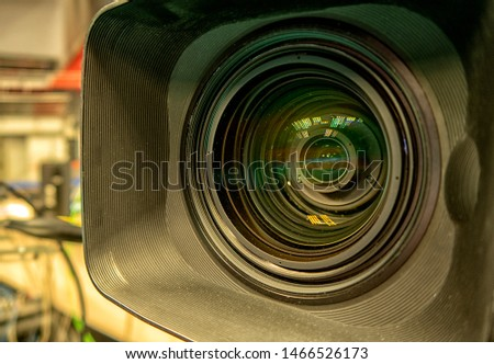 close up of a television lens  on a dark background. Camera lens,Macro of an iris,Camera - Photographic Equipment, Lens - Optical Instrument, Circle, Metal, Single Object. #1466526173