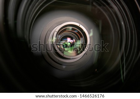close up of a television lens  on a dark background. Camera lens,Macro of an iris,Camera - Photographic Equipment, Lens - Optical Instrument, Circle, Metal, Single Object. #1466526176