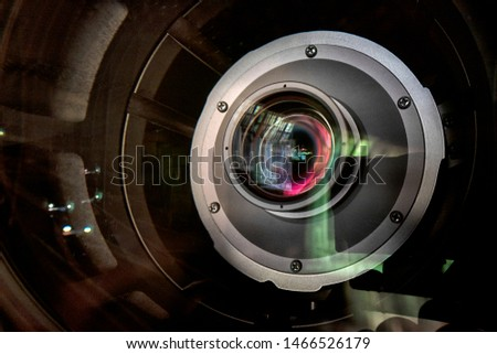 close up of a television lens  on a dark background. Camera lens,Macro of an iris,Camera - Photographic Equipment, Lens - Optical Instrument, Circle, Metal, Single Object. #1466526179