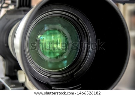 close up of a television lens  on a dark background. Camera lens,Macro of an iris,Camera - Photographic Equipment, Lens - Optical Instrument, Circle, Metal, Single Object. #1466526182