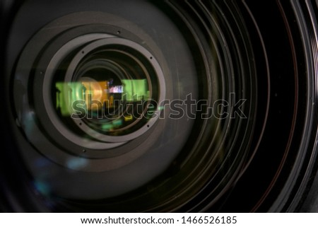close up of a television lens  on a dark background. Camera lens,Macro of an iris,Camera - Photographic Equipment, Lens - Optical Instrument, Circle, Metal, Single Object. #1466526185