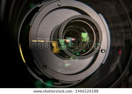 close up of a television lens  on a dark background. Camera lens,Macro of an iris,Camera - Photographic Equipment, Lens - Optical Instrument, Circle, Metal, Single Object. #1466526188
