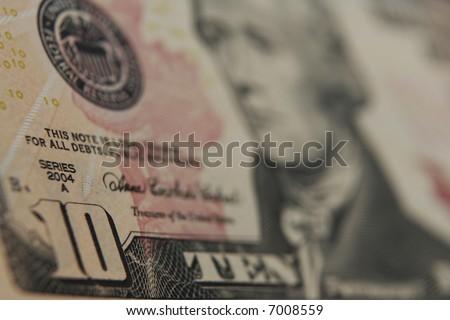 Close up of a ten dollar bill.