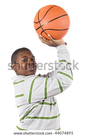 Close-up of a ten-year old African American ready to shoot a basketball into a hoop.  Isolated on white.