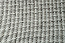 Close-up of a textured fabric. Macro shot of gray upholstery for furniture. Wallpaper and background. Closeup grey fabric texture. Thick gray material for the interior
