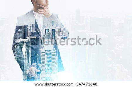 Close up of a thinking businessman standing with his hand in a trousers pocket and looking to the distance. Cityscape is at the foreground. Film effect. Toned image. Mock up. Double exposure #547471648
