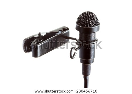 Close-up of a tie-clip microphone with a white background