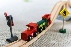 Close up of a toddlers wooden train railway set