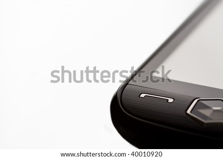 Close up of a touch screen cellular phone isolated on a white background with shallow depth of field