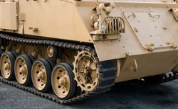 Close up of a tracked troop transport vehicle