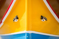 Close up of a traditional Luzzu Fishing Boat and the eyes on the front that see the way. Popular tourist site in Malta.