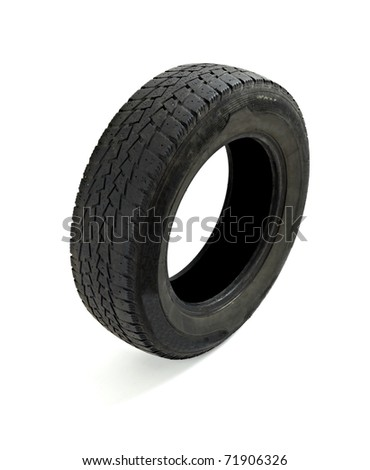 close up of a used car tire on white background