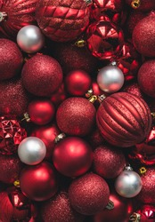 Close up of a variety of red and white Christmas ball ornaments.