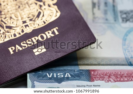 Close up of a Visa document and passport. Immigration and emigration concept