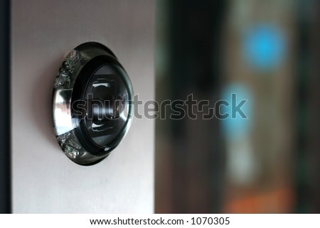 Close-up of a visitors-camera in a building
