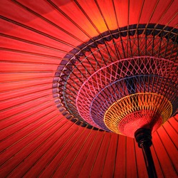 Close up of a wagasa, a red traditional japanese umbrella, view from inside