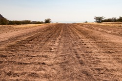 close up of a washboard gravel road in Namibia