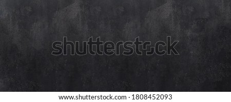 Close-up of a weathered and aged dark gray, almost black, concrete wall, texture background. Photo stock ©