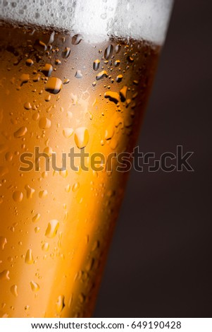 Close up of a wet pint of cold pale beer