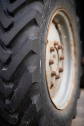 Close-up of a wheel of a tractor Belarus. Strong tread ridge on the wheel. Rural life