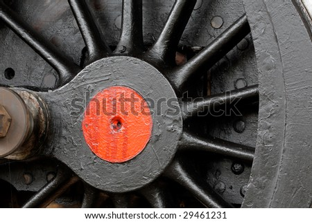 Close-up of a wheel of a vintage steam locomotive