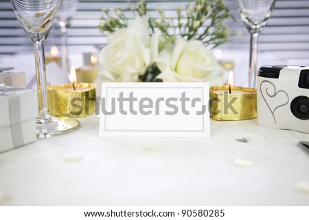 close up of a white blank name card on a wedding table