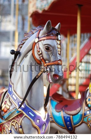 close up of a white carousel...