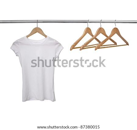 close up of a white t shirt on cloth hangers in row